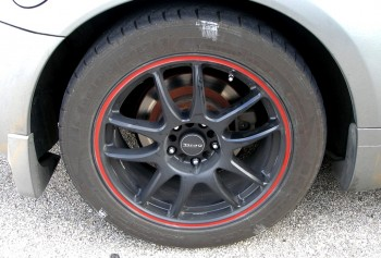 Marked tire sidewalls on Steven's Drag brand wheels w/distinctive red stripe
