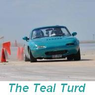 Craig's Teal Turd, blowing through cones at a SPOKES SMA autocross.