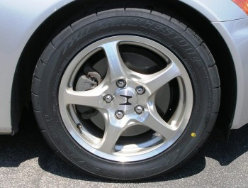 The Bridgestone Potenza RE-11 tires on the stock rims