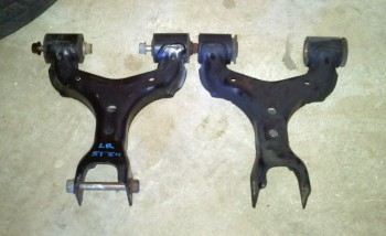 Replacement vs. slight bent original left rear upper control arm