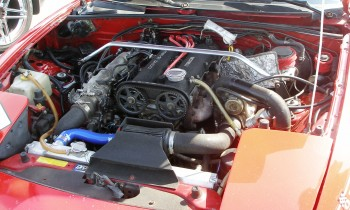 The engine bay of this street legal, but racing capable, 1995 Mazda Miata