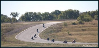 Motorcycle enthusiasts racing up to Santa Rita curve at Harris Hill Road.
