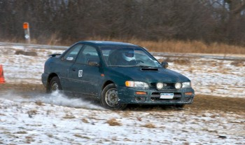 RoadRally Subaru, carving through a frozen, unpaved corner at speed!