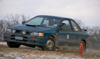 RoadRally Subaru, working a frozen, unpaved  course section at speed!