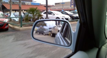 Blurry shot of Karlino being towed into the North Park Mazda dealer lot.