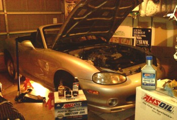Karlino Miata, up on jack stands in preparation for an AMSOIL synthetics infusion!