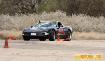 Eric driving Jay's Z06 (Vader) at the SCCA TX Tour Nat'ls, by gotcone.com