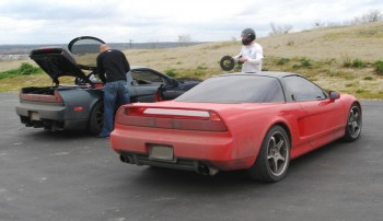 Chris' NSX is red, Scott's is gray/black - both nice cars for street & track!