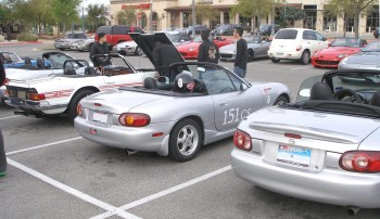 "Karlino in ""autocross attire"" with his Miata & English bretheren..."