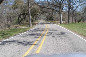 Hill Country county road - going through the trees, near a creek...