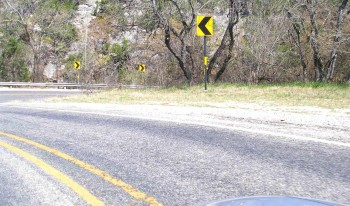 Highway 16 switchback hairpins - note the changing directions of the arrows!