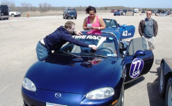 Jay helping Tia apply the SCCA-approved Tire Rack decals...