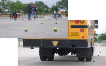 The rear wheels thru the decreasing width tennis balls!