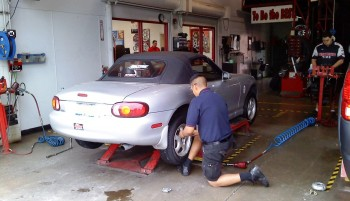 Discount Tire guy prepping to torque the lug nuts on Karlino...
