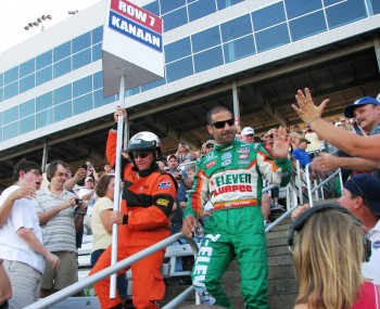Tony Kanaan parting the waves of fans as he makes his way to the IndyCar Firestone 550K starting grid at the Texas Motor Speedway.