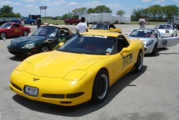 Eric's Sunshine 'Vette with Ray's his silver Lotus Elise behind...