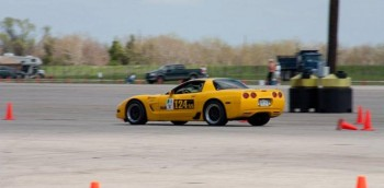 Here's Eric willing himself beyond the wannabe stage, during an autocross run at the 2011 SCCA Houston Tour...
