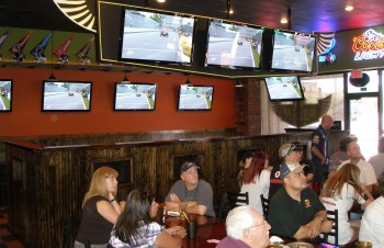 The Austin F1 Club, Montreal GP watching party, showing the entrance of Wingzup with lots of screens, in Austin, TX