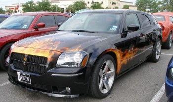 They even had a car on fire, a Dodge Magnum, at the informat C&C show @ Panera's, San Antonio, TX - 25-JUN-2011