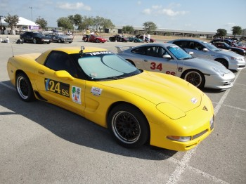 Eric's Corvette (Sunshine) waiting in anticipation, proudly wearing the RacingReady.com static clings!