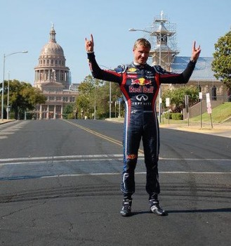 David Coulthard, Red Bull Racing Show Car driver, showing the crowd he can Hook 'Em Horns with the best of them!