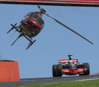 Jenson Button, Vodafone Formula 1 driver, getting buzzed by a helicoptor