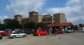 Cars on grid, waiting to autocross on the smaller Retama parking lot course...