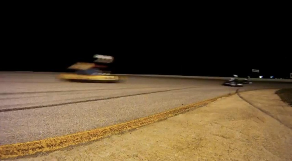 That yellow blur is Racing Ready Dan at TOO high a racing line - Chevy Fast & Fuel Efficient, by DrivingTheHeartland