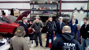 James Willson & Brianne Corn facilitating the Drivers' Meeting in her BCR shop