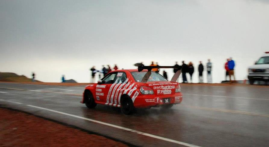 Brianne Corn's 2005 Subaru Sti, at speed , racing by in the rain at 2012 Pikes Peak
