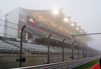 CoTA front straight grandstands, shrodded in the foggy mist start of the 2012 Formula Run
