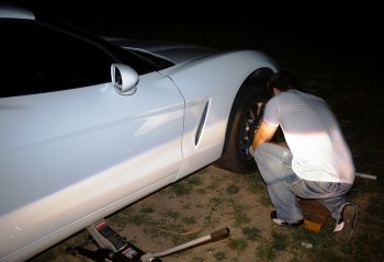 Dealer bound for Eric's new Ford Mustang 5.0, former class competitor Jay has to change a tire