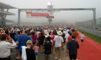 Mass quantities of humankind (at least 5000) at the start of the 2012 Formula Run at Circuit of The Americas - it was SO foggy!