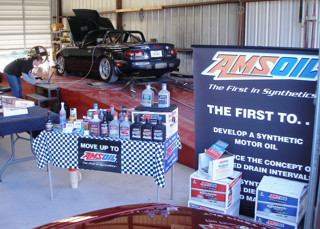 AMSOIL display with dyno session in progress at Lone Star Dyno with BEGi